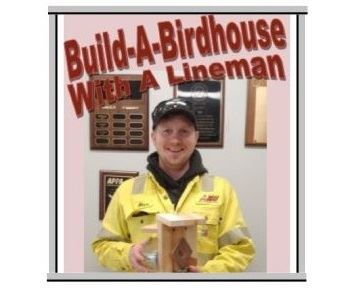 Lineman holding reused meter birdhouse creation for Spring 2020 Build-A-Birdhouse event.